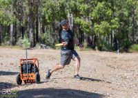 An image showing man playing disc golf frisbee