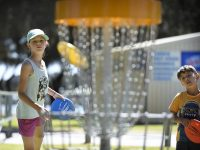 An image showing kids playing disc golf frisbee