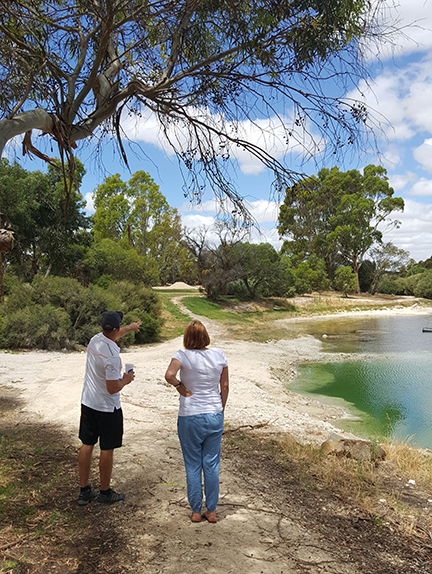 An image showing a women and a man wearing white shirt discussing about Tintinara Disc Golf Course Design.