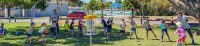 An image of group of kids playing disc golf