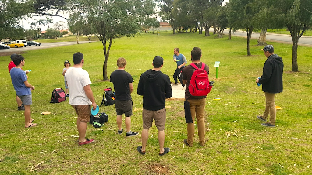 an image of group of men playing disc golf