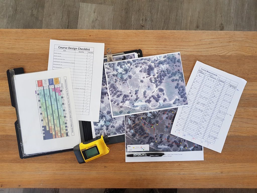 an image of papers and designs of a disc golf course