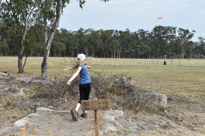 an image of a girl playing disc golf in Granite Mountain Disc golf course