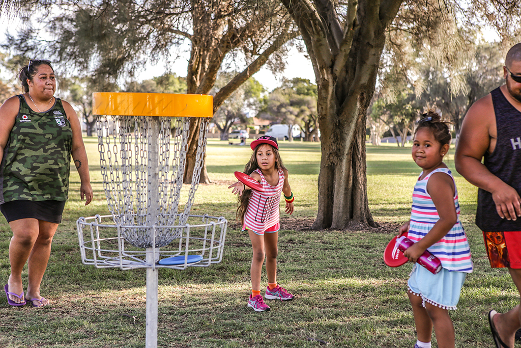 an image of a family playing disc golf
