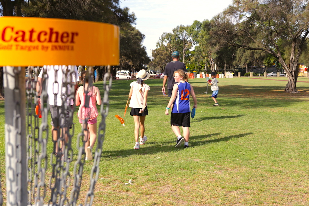 an image of boys and girls playing disc golf