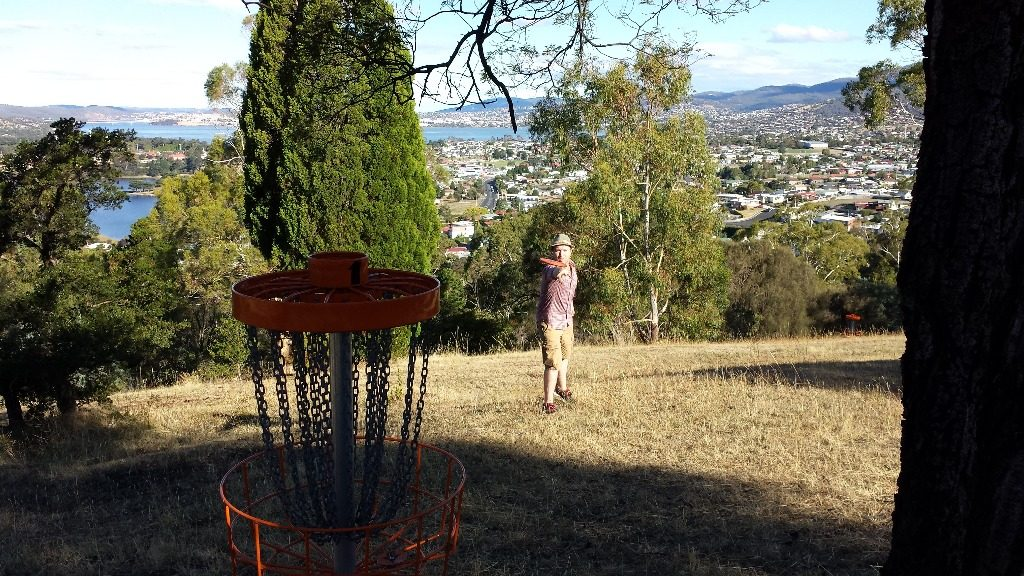 an image of a man playing disc golf in a disc golf course