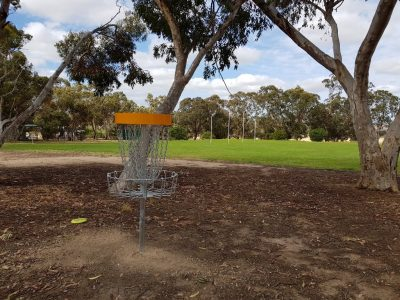 an image of a disc golf basket target in a disc golf course