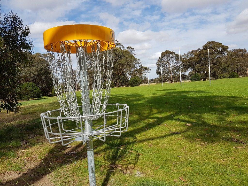 an image of a disc golf basket hole