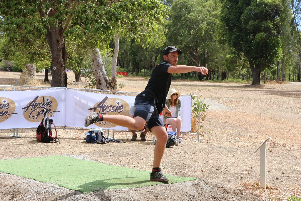 an image of a man playing disc golf in a tournament