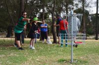 an image of family playing disc golf in disc golf park