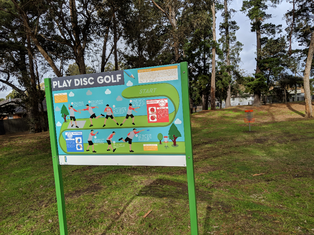 an image of signage play disc golf
