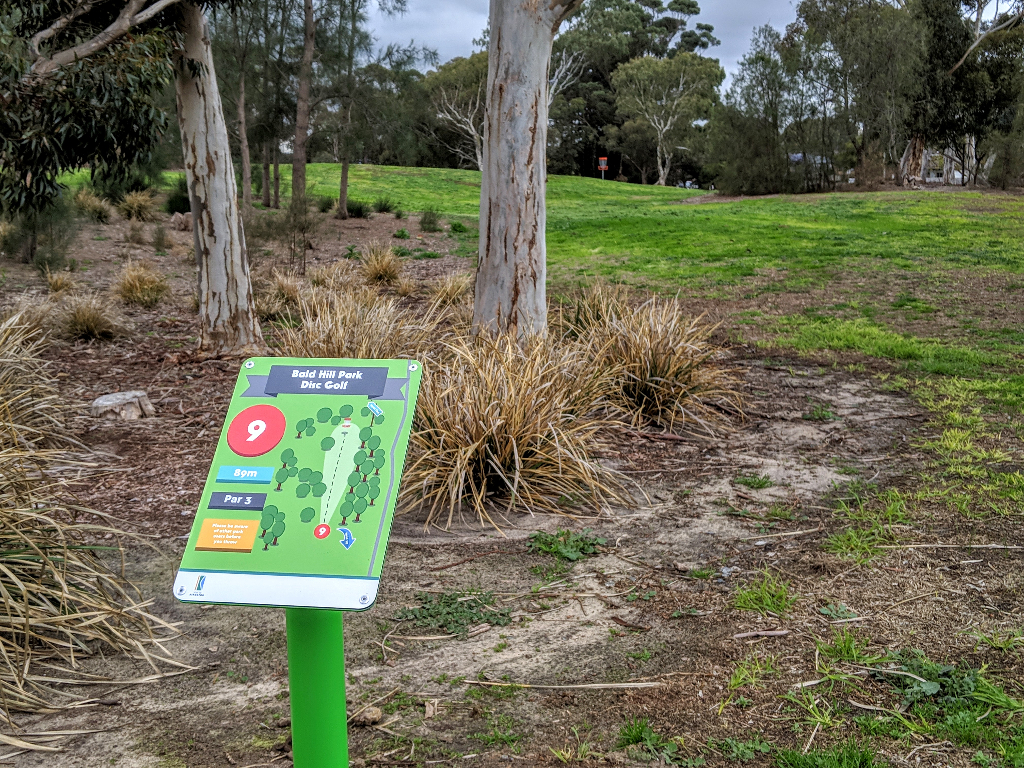 an image of disc golf tee sign