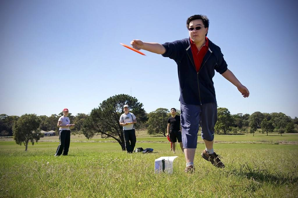 an image of a man playing disc golf