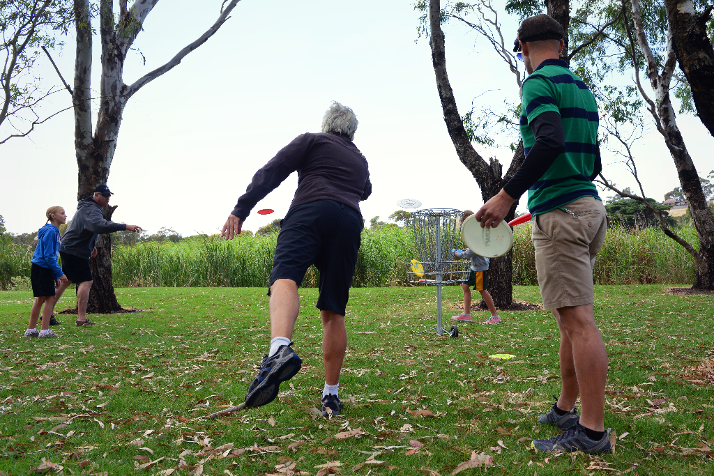 an image of group of people playing disc golf
