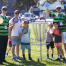 an image of kids and men holding frisbee beside a disc golf basket target