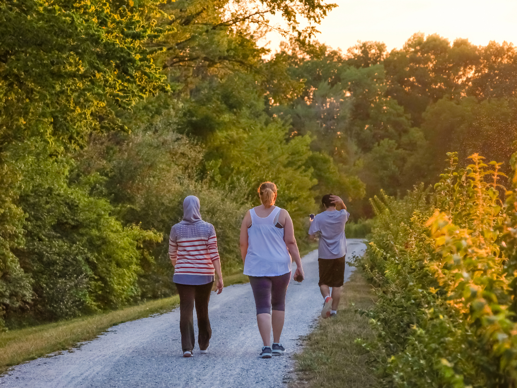 an image of women walking at disc golf park